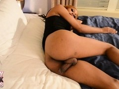 Chocolate beauty Sparkle stroking off her stiff cock
