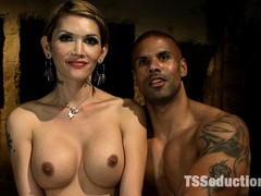 Petit TS Dom, Eva Lin, fucks Robert Axel with her hard, thick cock. She bends the body builder over and rams him up the ass until they both cum.