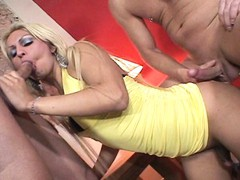 Two guys and a tranny blowing and fucking each in this scene