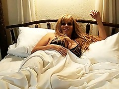 Transsexual Jesse masturbating in the bed
