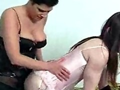 Tgirl Kirsty gets in the middle of a horny crossdresser orgy