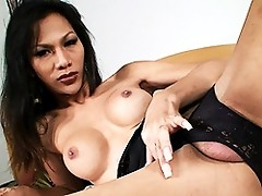 Naughty exotical tranny playing with herself