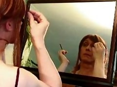 Lucimay putting on her make up and smoking