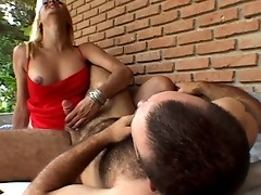 Strong guy jerking off and sucking shemale's cock before spreading his legs