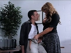 Shemale Carmen Cruz assfucks her office boy and eats her own cum.