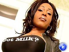 Thick black tattooed shemale shows off her thick ass and huge cock
