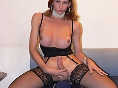 Suzanne Raul is a smokin hot tranny with firm tits a tight ass and a huge cock