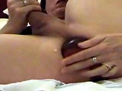 TV slut Karen fucks her tight ass with a big dildo