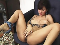 Pop impales her Ladyboy pussy with a huge dildo