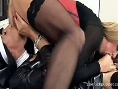 Zoe dressed in a nun outfit and sucking some tranny cock