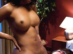 The voluptuous TS Sexy Jade shoves her hard, black cock into a tied up white guys mouth.